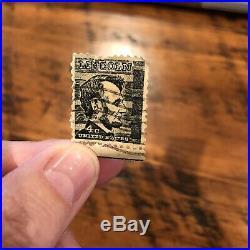 Abraham Lincoln 4 cent black stamp used