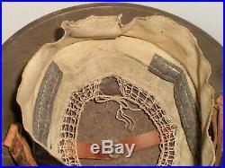 Original U. S. WW1 M1917 helmet, stamped ZC177 with Orig. USMC badge